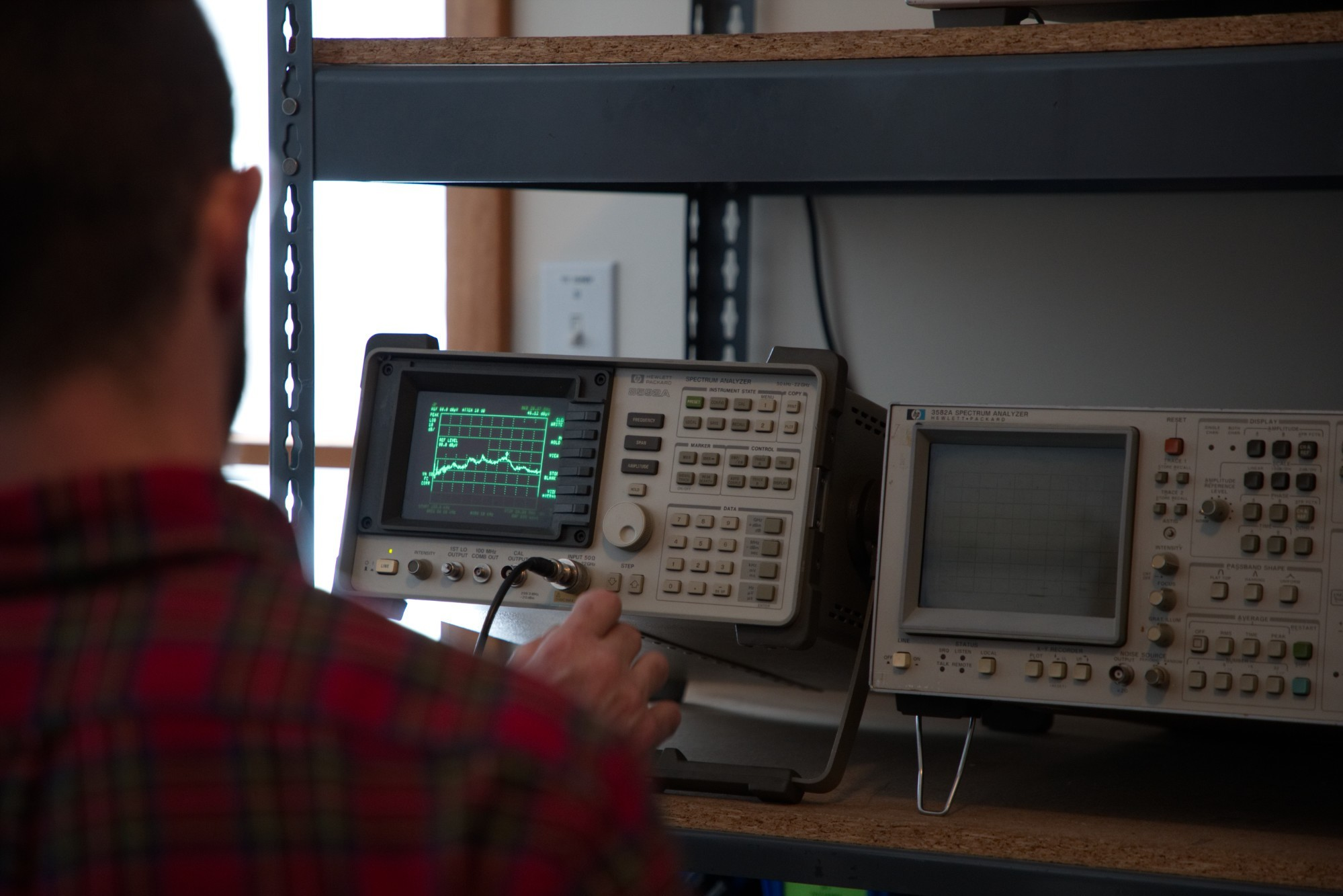 A photo of a GME tech peforming maritime FCC testing and aviation FCC testing at the Vermont lab